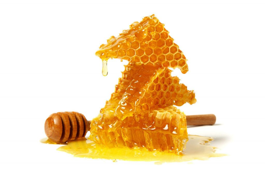 Sometimes honey is served with its honeycomb counterpart.